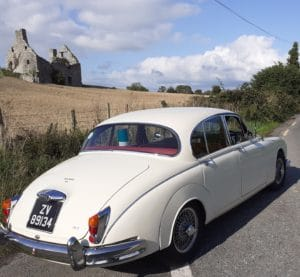 Classic Jaguar Wedding Car in Old English white