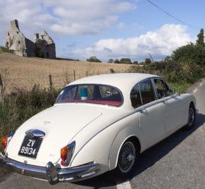 Traditional white wedding car