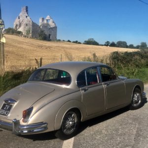 Summer sun Jaguar wedding car